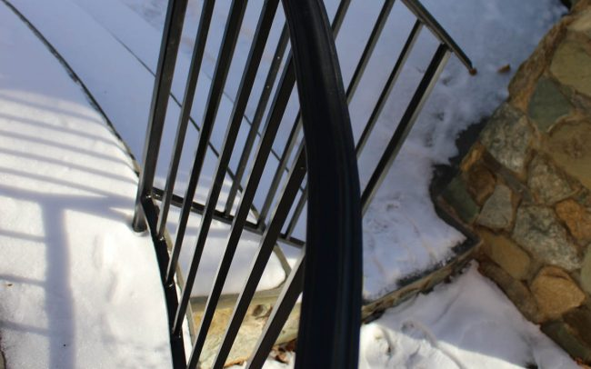 Exterior black powder coated wrought iron rail_curved_core drilled_base plates_solid posts_half inch balusters