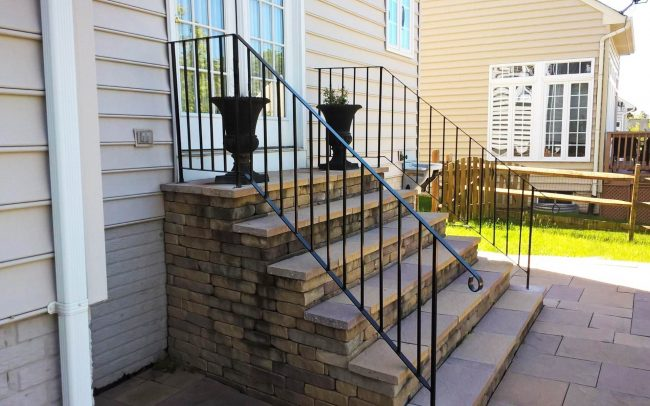 Exterior wrought iron rail_solid post_flat bar handrail_half inch square balusters_cement anchors and base plate_powder coated black_2