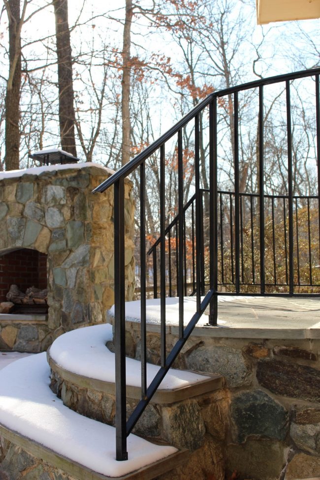 Exterior wrought iron railing_core drilled_solid posts_square balusters