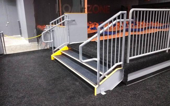 Interior metal railing_schedule 40 pipe rail_round vertical balusters painted to customer color choice. Metal stair_tread pan_Skyzone