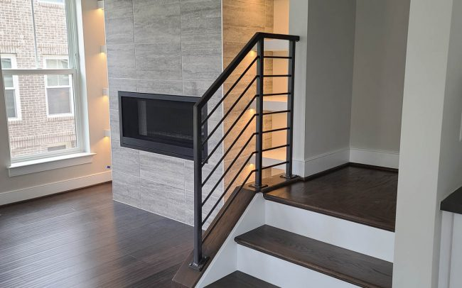 Modern interior metal railing_hollow posts and round bar balusters_powder coated