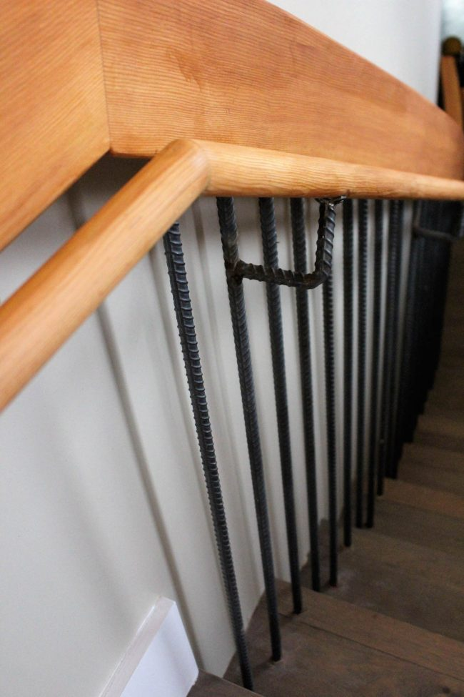 Stained_finished wood rail and round subrail_balusters and rail bracket from rebar_flat clear on rebar for beautiful rustic look