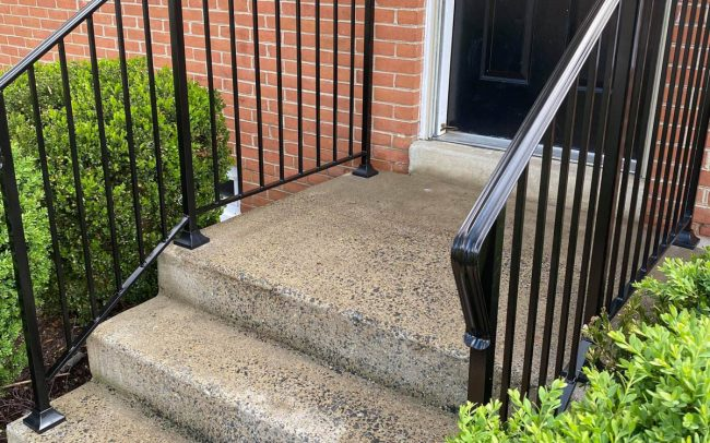 exterior wrought iron rail_solid post_ half inch square balusters_core drilled_epoxy into cement_painted black