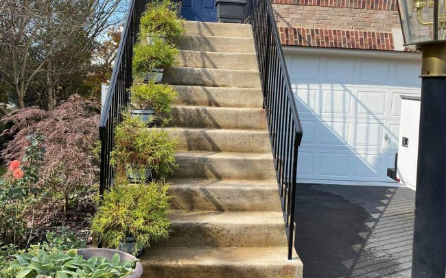exterior wrought iron rail_solid post_ half inch square balusters_core drilled_epoxy into cement_painted black_1