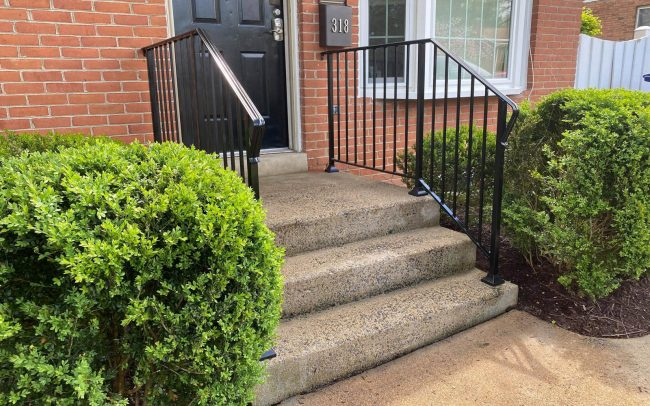 exterior wrought iron rail_solid post_ half inch square balusters_core drilled_epoxy into cement_painted black_2