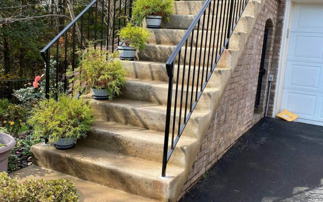 exterior wrought iron rail_solid post_ half inch square balusters_core drilled_epoxy into cement_painted black_shoe covers