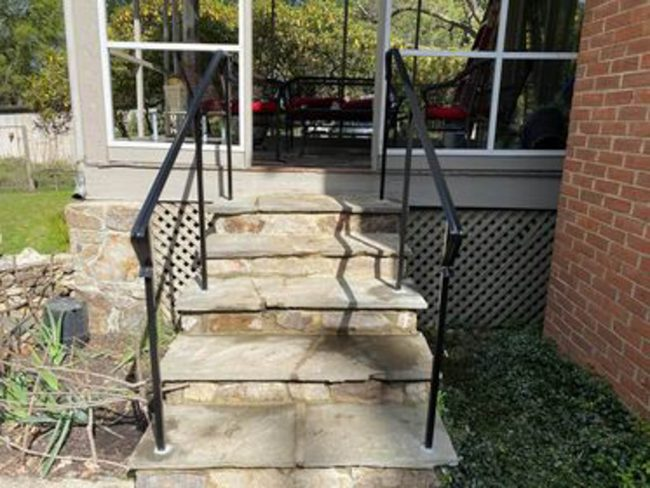 exterior wrought iron rail_solid post_core drilled_epoxy into flagstone_painted black_1